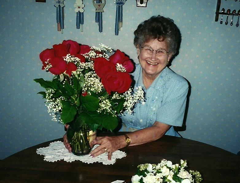 June Berg with our anniversary flowers from David
